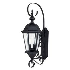 Capital Lighting 9722BK Carriage House 2-Light Exterior Wall Lantern, Black Finish with Clear Glass by Capital Lighting. $155.31. Capital Lighting 9722BK 2-Light Exterior Lantern features a dramatic Black finish complemented by Clear glass making this a timeless piece to enjoy for years to come. Hang near a front door for classic charm, or place on a garage door with the simple elegance. The 9722BK is 9.5-Inch wide by 27-Inch high by 12.75-Inch extension from the wall. The 9722BK...