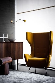 Like the velvet Mustard yellow wingback chair- very 1950's chic.