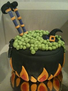 Thank you MaryPily for the idea and inspiration. I made this cake for a cake walk at my sons school Family Fall Festival. It is a pumpkin cake with cream cheese icing filling. It is covered in fondant with fondant details.