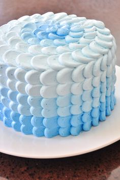 A friend in my ward asked me to make a baby shower cake for her sister that's pregnant for the first time.  I'm assuming from the colors they chose (grey, orange, and blue) that she was…