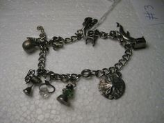 Vintage 1960's on Sterling Silver Charm Bracelet by stampshopgirl