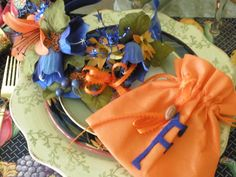 """2011 Go Gators! Made little bags filled with goodies, cut out """"F"""" in felt and added ribbon and little football. Also made Visors for the game in all the Gator colors."""