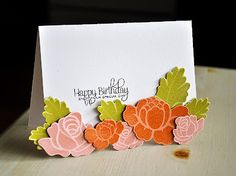 """Heat embossing on Color Cardstock.  Also, bottom of front is trimmed and the flowers added to """"fill in"""" trimmed area."""