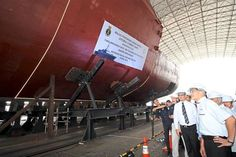 Ready for action: Hishammuddin (left) having a look at the LCS during its keel- laying ceremony at the Boustead Naval Shipyard in Lumut. — Bernama