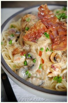 Country Club Chicken 1 pound spaghetti 4 chicken breasts 1 large onion 7 oz mushrooms 1 can concentrated cream of mushroom soup (1 Unox or 2 Campbells) 4 or 5 slices bacon 1/4 cup dry white wine 2/3 cup sharp cheddar 1 apple butter or oil salt pepper