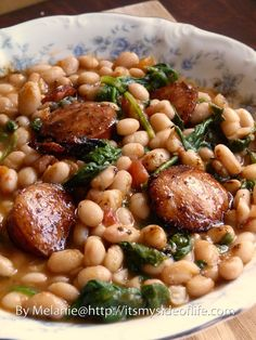 White Beans with Spinach & Sausage. Making this tonight using Kale instead of Spinach. Sounds like such a good cold weather meal. Approx 6 g fat / 200 cal per (1 cup) serving. High in dietary fiber, iron, manganese and vitamins A and C. Nutrition Grade: A