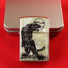 This zippo style lighter is uniquely ornamented with an intricate mother of pearl design of a tiger under moonlight. The tiger which is considered a mystical creature, is not only a symbol of bravery and courage but also believed to have magical power that drives out devils and diseases. Visit our website for more gift / gift ideas; antiques perfect for anniversary gifts