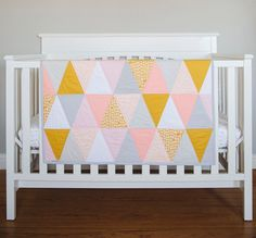 """This triangle quilt is so gorgeous! """"The Ellie"""" is handcrafted with hues of Coral, Mustard, Light Grey, White and a Black & White petite polka dot all 100% cotton quilting grade fabric. The backing is"""
