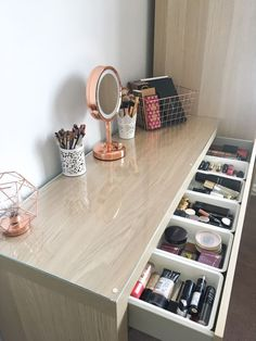 My makeup storage: Featuring the Ikea Malm dressing table - BeingChloe. How I organise my makeup collection. The ikea malm dresser makeup storage and organisation. The ikea malm drawer organiser with billigen drawer inserts.