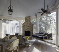 """""""The entire area is for entertaining, including a screened in porch and an outdoor porch. It's a huge space, so I wanted to make it warm and cozy so that when it's just the two of them it doesn't feel cavernous. I added big pieces of furniture and lots of small details to make the space warm and inviting."""""""