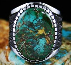 Alton Bedonie, Navajo artist:  ring features a stunning gem grade natural spiderweb Royston turquoise. The gem is blue and blue green with elegant and complex reddish and golden-brown webbing, the highest grade found at this classic turquoise mine.