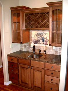 Some ideas here I could use for my coffee bar, including the wine rack and upper cabinets.