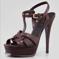 Yves Saint Laurent Tribute Sandal Dark Red 9.5US Saint Laurent Tribute platform sandal, in a rich, wine-red hue. The Saint Laurent With leather Sandal rests on covered 1 1/2 platform with beveled front and 5 3/4 heel; 4 1/4 equiv.                       Condition: These beautiful pumps are worn only 3 times. They are 100% authentic or money back guarantee, however they do not come with box. They have a few signs of worn on insoles and soles but not that visible when you wear them. There is…