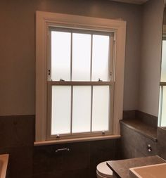 Bathroom installation with vertical bar detail and obscure glass