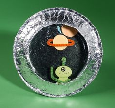 Space Ship Porthole Cute spaceship porthole craft w/ paper plates, aluminum foil, pipe cleaners. Could pre-make some aliens and planets for the little ones, if needed? Space Projects, Projects For Kids, Summer Crafts For Kids, Art For Kids, Outer Space Crafts For Kids, Preschool Crafts, Kids Crafts, Art Crafts, Alien Crafts