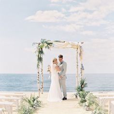 This is one of the prettiest #chuppahs we've ever seen! Aren't you just loving this #LakeMichigan #wedding?! #bride #groom | Photography: @clarypfeiffer | Coordination: @sincerelygingerweddings | Floral Design: @thedaysdesign | Wedding Dress: @lelarose | Groom's Attire: @altonlane by smpweddings