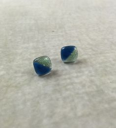 Aqua Paco Studs - These studs are a creative way to add a little color to your day. Handmade in Bolivia from recycled glass, the co-op's empowerment model is implemented holistically, providing artisans with access to quality healthcare, design education, business training, and community building.