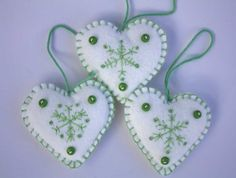 Felt Christmas Heart decorations. Green embroidered  Snowflake ornaments.. $18.00, via Etsy.