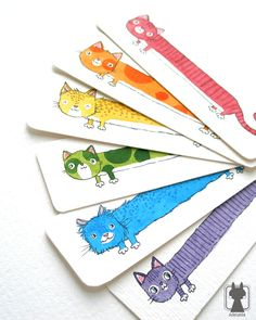 Rainbow cat bookmarks http://www.etsy.com/shop/Adelaida?section_id=7220988