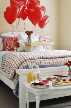 breakfast in bed with red heart balloons and flowers-- OH YES WE LOVE THIS!