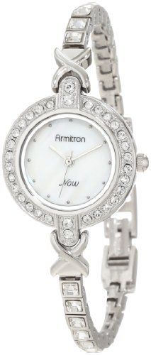 Large 47.5 mm round polished silver-tone case. Genuine mother-of-pearl dial  with silver-tone frame and 12 small pearling indexes. 1bdd5ab4a05