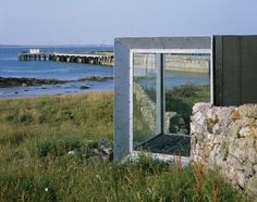 An Turas Ferry Shelter by Sutherland Hussey Architects The tunnel is open to the sky, but sheltered from the wind; the bridge is protected from the top and sides, but open to the rock and sand of the. Glass Boxes, Scottish Highlands, The Rock, Shelter, Small Spaces, Exterior, Sky, Architects, Beach
