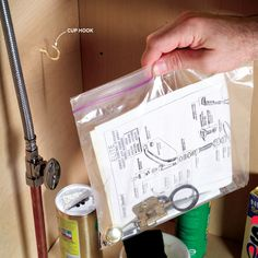 Don't file away the manuals for your kitchen and bath fixtures. Instead, slip them into a locking plastic bag and hang the bag in the cabinet under the sink. They'll always be right where you need them. Toss in paint samples and spare cabinet hardware too.