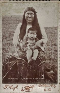 Comanche Pia or Mother and Onaa or Child (c.1899) by F. Croft - The kohno or day cradle laying beside her was used to keep a baby out of harm's way. If the mother was gathering seeds or roots and on the plains, it could be easily carried on her back.