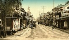 """Ca.1895-1900 This view looks Southeast down Benten Street, called in Japanese, """"Benten Dori"""". - This shop-lined avenue is where almost all albumen souvenir photographs of Japan were made during the 19th Century."""