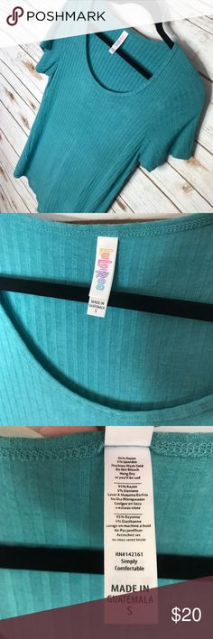 Pre Loved LuLaRoe Classic T Small This beautiful Classic T is a lovely teal color. It is nice and stretchy and ribbed. This is a lovely basic and is in like new condition with no pilling. Perfect to go with print leggings or layered with your skirts! LuLaRoe Tops Tees - Short Sleeve