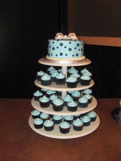 Cupcake Tower for nephew's baby shower!  Cake and cupcakes were made by Sara Jones, she does a great job with cakes!!