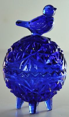 This wonderful vintage covered dish is beautifully rendered in a deep cobalt blue and measures approximately 3 inches in height. The item was
