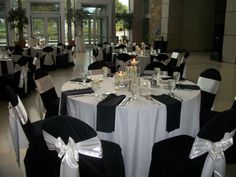 So No Chair Covers But This Will Be Similar To Our Tables. White And Black  Table Cloths Offset And A Black Napkin