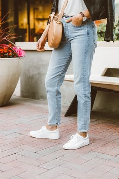 Casual sneaker style. #zapposstyle #kedsstyle #ladiesfirst Keds Sneakers, white leather sneakers, how to wear white sneakers, white sneaker style, casual style, jeans and sneakers, athleisure style, on-the-go style, mom style, circle bag for spring, light wash jeans and tee outfit, women's casual outfits, spring style, effortless spring style, everyday outfit ideas, how to layer for spring, spring layers
