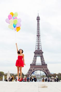 Fashion blogger, Nicole Warne / Gary Pepper Girl, shoots at the Eiffel Tower in Paris with balloons