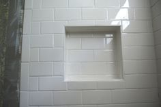 traditional subway tile | Subway tile with white grout built in niche in shower.