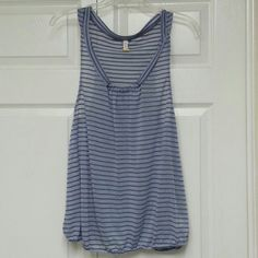 FREE PEOPLE Striped Tank Top Size L, 60% cotton 40% polyester, very cute purple stripes, loose fit tank top, a little sheer, longer arm holes, lightly worn, .... ask me anything! Free People Tops Tank Tops