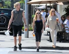 Chloe Grace Moretz enjoys lunch with her brother Trevor and their mom Teri on July 11, 2014 in Beverly Hills, California