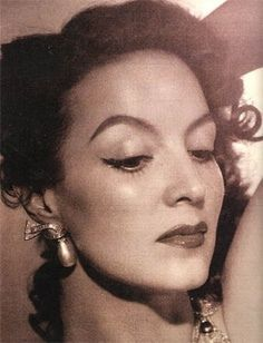 """Maria Felix was born in Sonora, during the tempestuous time of the Mexican Revolution in 1914. She was better known for her roles in the Mexican Golden age of Film, during the 1940s and the 1950s. With an eyebrow perpetually raised she portrayed the roles of strong willed women in movies with titles as fiery as her personality: """"Juana Gallo"""" (Rooster Joanne), Dona Diabla (Lady Devil) & """"La Mujer sin Alma"""" (The Woman without a Soul). Maria had a 2nd wave of films & TV appearances well in2 the…"""