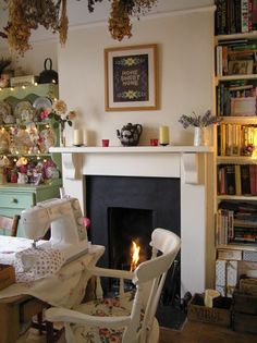 I hope one day I can have a fluffy, cozy and completely girly sewing room that I can decorate just like this... complete with those beautiful bookshelves.