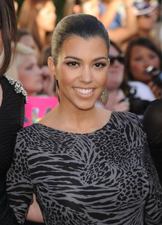 Kourtney Kardashian Ponytail - Ponytail Lookbook - StyleBistro | ohh kourt how i love ya, we even have the same hairline! super rare..