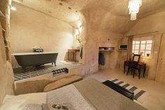 Located in converted caves in the Nazelles-Négron commune in France's Loire Valley, Amboise Troglodyte is a cosy, modern B&B with a nook bath area with tiled floors.