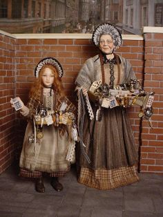 """ALL KINDS OF EVERYTHING - This Victorian habedashery peddler and her young apprentice were both made by me.  They certainly have """"all kinds of everything"""" available for sale."""
