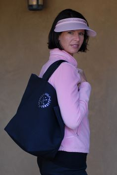 Ladies Clip on Visor with Crystal Headband.  Shown in Powder Pink with Light Rose Crystals.  Tote with Golf Crest Design.  Made with Swarovski Elements. $68