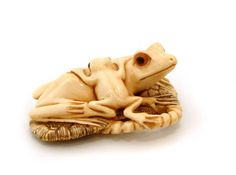 Mammoth Ivory Netsuke - Frog & baby Frog - mammoth ivory being from an extinct creature and able to be legally traded, unlike elephant ivory. If we don't want elephants to follow the mammoth into extinction, please say NO to conflict ivory products - contemporary works in ivory from elephants that are being slaughtered at a rate that is pushing some African elephant populations onto the endangered list..