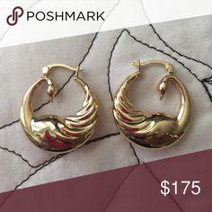 Calling all swan lovers! 14 karat gold earrings Brand new; never worn.  14 karat gold swan hoop earrings. Lovely expensive earrings just not my style. Jewelry Earrings