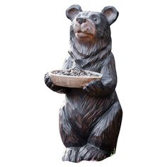 Brimming in woodland charm, this friendly bear statuette offers a bowl of seed to your feathered backyard visitors.