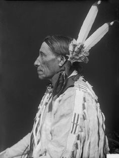 Portrait of War Chief To-Ka-Kin Uyaya (Runs The Enemy) in Native Dress with Headdress MAR 1910. Dakota Two Kettle Delegations. Creator: De Lancey W. Gill. National Anthropological Archives, Smithsonian Institution