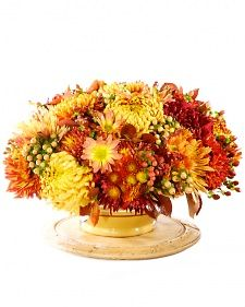 Martha demonstrates how to make a beautiful Thanksgiving centerpiece using mums. Martha Stewart