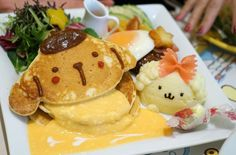 """""""Tokyo has many theme restaurants dedicated to cute characters, such as Pokémon and Hello Kitty. Pompompurin Café celebrates one of the lesser-known Sanrio mascots, a yellow puppy in a beret,"""" says La Carmina.""""All of the food is adorably decorated with smiling animal faces – but the flavor combinations, like chocolate pancakes, a bowtie noodle, and mashed potatoes — will leave you scratching your head."""""""